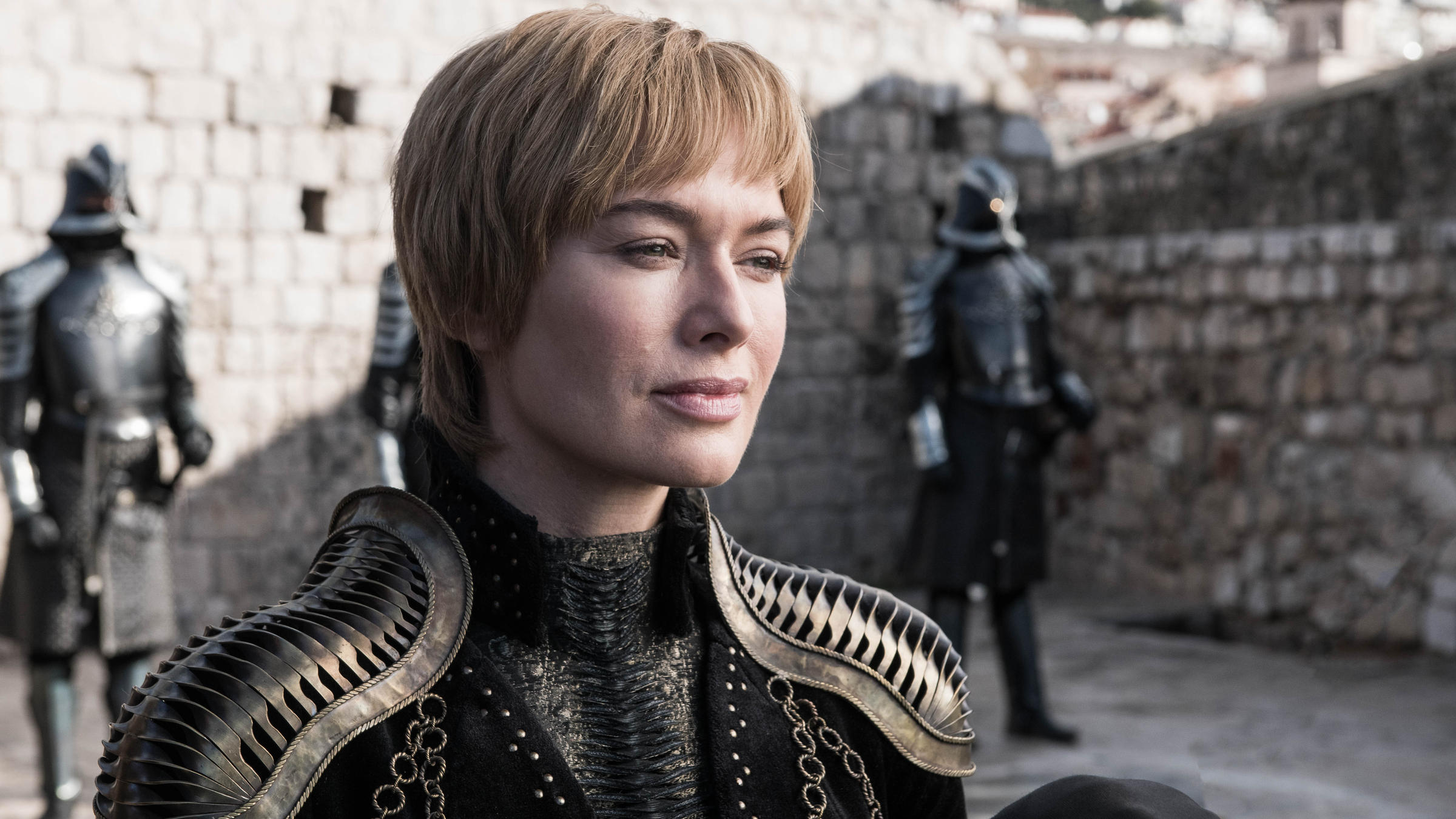 Queen Cersei (Lena Headey) smiling that smile of hers on Game of Thrones. Shoulder pads courtesy Julia Sugarbaker.