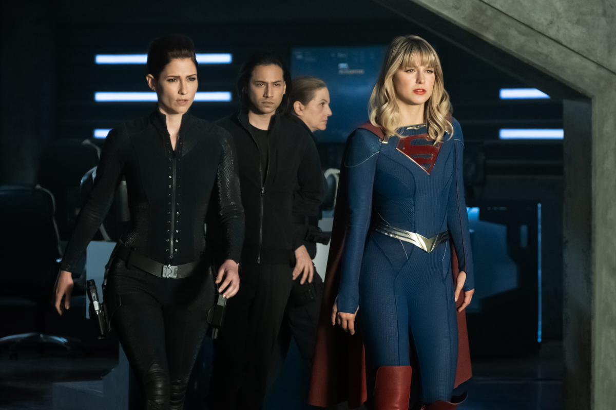 "Supergirl -- ""Crisis on Infinite Earths: Part One"" -- Image Number: SPG509b_0013r.jpg -- Pictured (L-R): Chyler Leigh as Alex Danvers, Jesse Rath as Brainiac-5 and Melissa Benoist as Kara/Supergirl -- Photo: Katie Yu/The CW -- © 2019 The CW Network, LLC. All Rights Reserved."